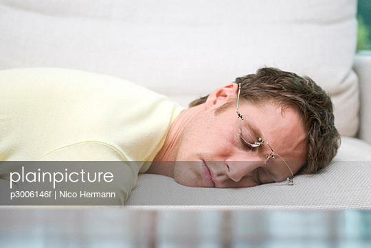 Man with spectacles sleeping peacefully