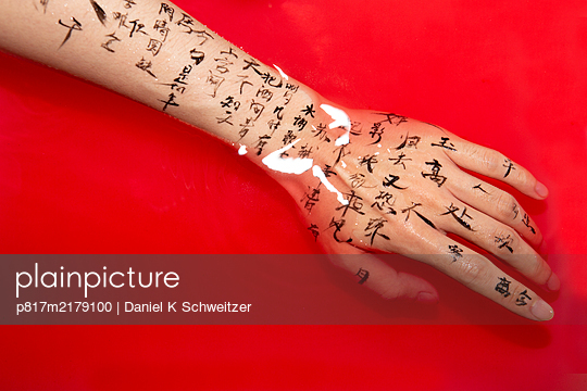 Chinese characters as tattoo on the forearm - p817m2179100 by Daniel K Schweitzer