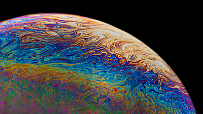 Colourful soap bubble like a planet in space, fantasy - p1652m2230702 by Callum Ollason