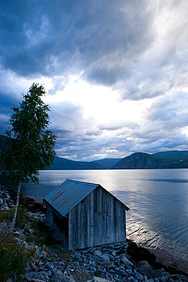 Fishing hut and upcoming storm in Norway - p2481084 by BY