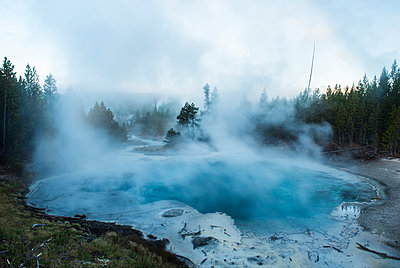 Scenic view of steam emitting from hot spring at Yellowstone National Park - p1166m1509447 by Cavan Images
