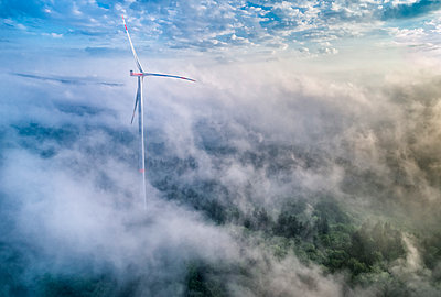 Germany, Baden-Wuerttemberg, Schurwald, Aerial view of wind wheel and morning fog - p300m2005380 by Stefan Schurr