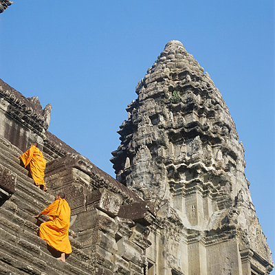 Buddhist monks climbing steps of Angkor Wat - p6440654 by Martin Stolworthy