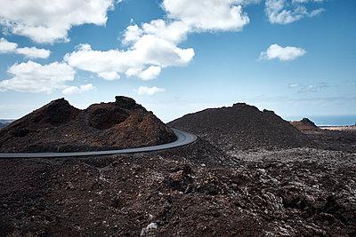 Winding road in Timanfaja national park - p851m1362498 by Lohfink