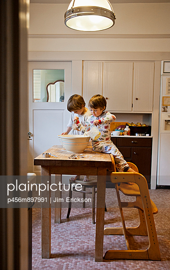 Two young boys mixing pancake batter for breakfast. - p456m897991 by Jim Erickson