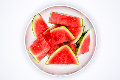 Watermelon slices on a plate - p1057m2008583 by Stephen Shepherd
