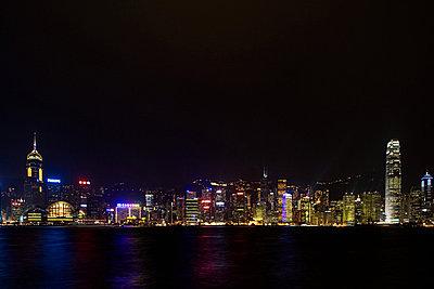 Hong kong skyline at night - p9247751f by Image Source