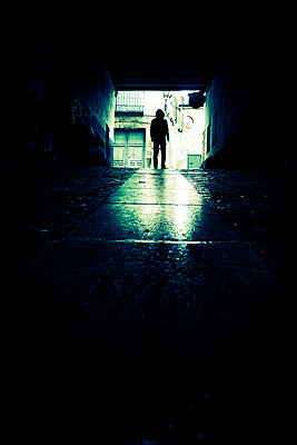 Silhouette of man walking into underground car park - p597m2142989 by Tim Robinson
