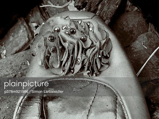 Close-up of shoe - p378m921986 by Simon Larbalestier