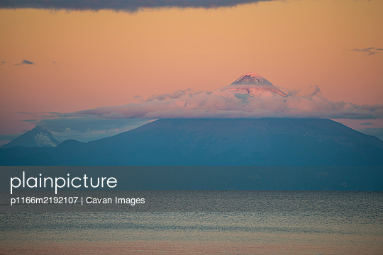 Osorno Volcano is a 2,652-metre (8,701 ft) tall conical stratovolcano - p1166m2192107 by Cavan Images