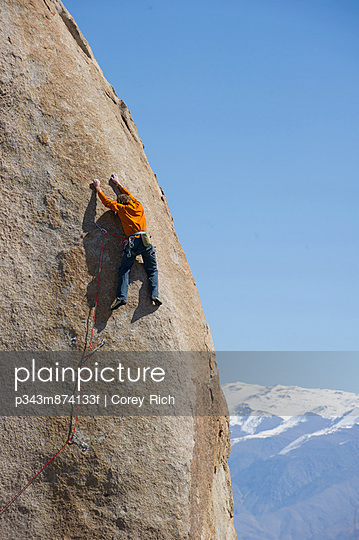 A man sport climbs in Bishop, California.