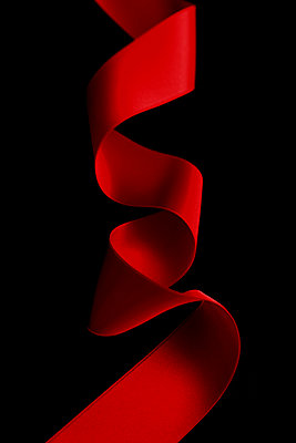 Red ribbon on black background - p450m1513081 by Hanka Steidle