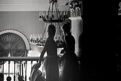 Caucasian teenage girls looking over balcony - p555m1306060 by Vladimir Serov