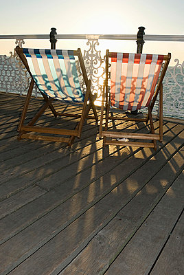 Deckchairs by the sea - p9248449f by Image Source