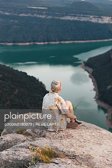Hiker on viewpoint, Sau Reservoir, Catalonia, Spain - p300m2180079 by REBELARTE