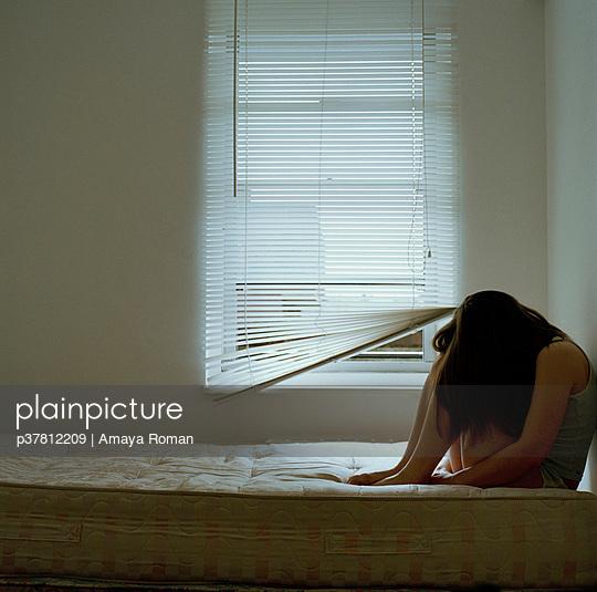 Woman on mattress - p37812209 by Amaya Roman