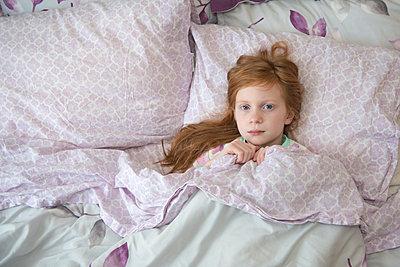 Sick Little Girl in Bed - p1166m2279637 by Cavan Images