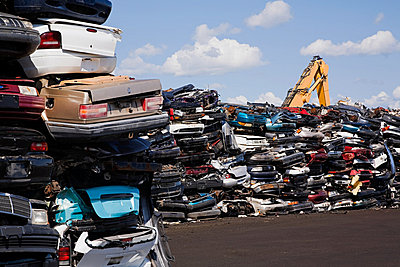 Cars in scrap yard - p9243815f by Image Source