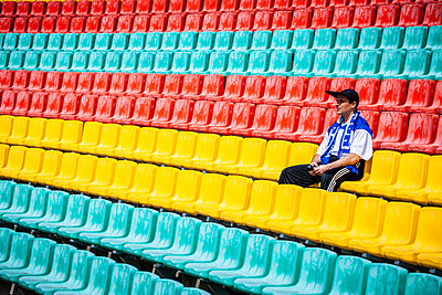 Single man on tribune in football stadium, Friedrich-Ludwig-Jahn-Sportpark - p1093m2193629 by Sven Hagolani