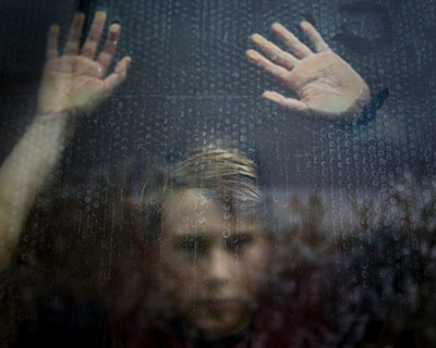 Boy Behind Glass - p1503m2015933 by Deb Schwedhelm