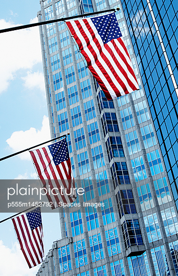American Flags Against Office Buildings