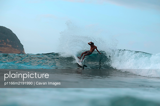 Surfer on a wave, Lombok, Indonesia - p1166m2191990 by Cavan Images