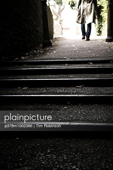 Man walking down path - p378m1002386 by Tim Robinson