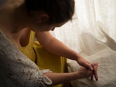 Depressed woman looking down - p945m1477519 by aurelia frey