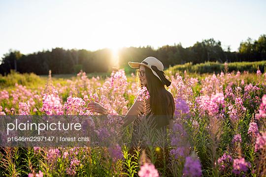 Woman on a flower meadow - p1646m2297147 by Slava Chistyakov
