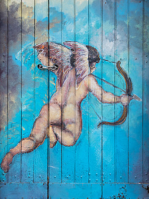 Cherub with angel wings holding Bow and Arrow street art - p1280m2215711 by Dave Wall