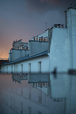 Clouds reflecting in flat roof - p445m1452449 by Marie Docher