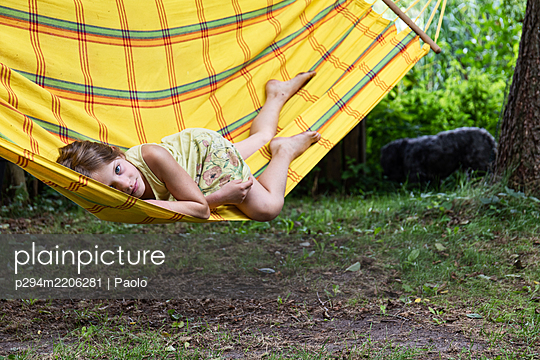 Girl in a hammock - p294m2206281 by Paolo