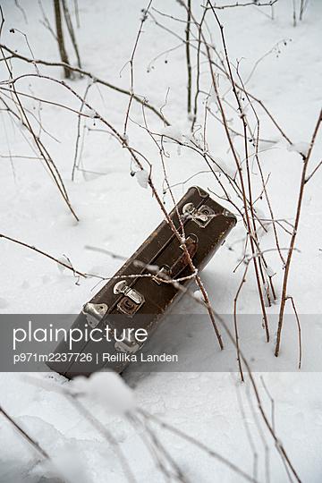 Old suitcase in snow - p971m2237726 by Reilika Landen