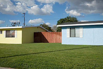 Two houses joined together by a fence - p495m903925 by Jeanene Scott