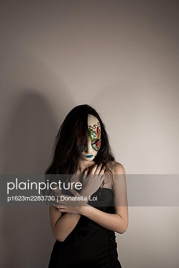 Girl with mask, portrait - p1623m2283730 by Donatella Loi