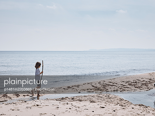 Girl on a sandy beach at the Baltic Sea, Sweden - p1481m2203869 by Peo Olsson