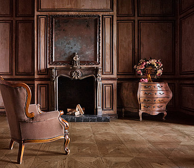 Wing chair at the fireside - p390m1477412 by Frank Herfort