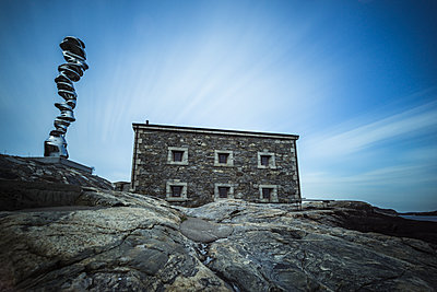 Stone house on rocky coast - p312m1522178 by Mikael Svensson