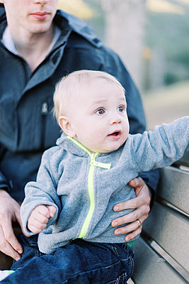 A 10 month old baby boy taking a break with his dad from hiking. - p1166m2162792 by Cavan Images