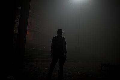 Man at night - p1007m1144325 by Tilby Vattard