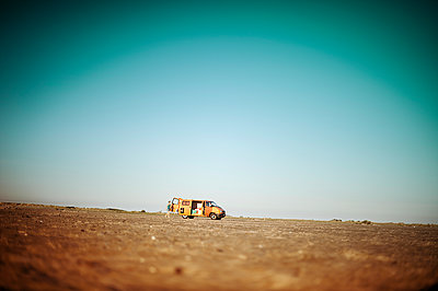 Orange van on a wild beach - p1007m1134077 by Tilby Vattard