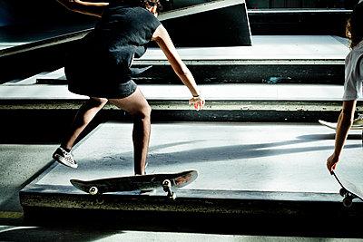 Teen girl in panty hose on skateboard - p445m2076814 by Marie Docher