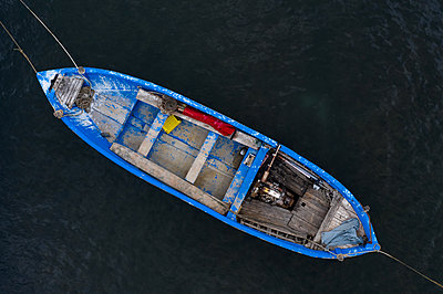 Aerial view of fishing boat in sea - p1596m2214820 by Nikola Spasov