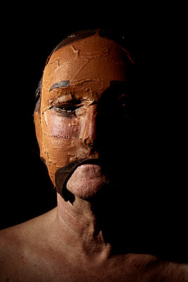 old man wearing a mask - p1540m2195872 by Marie Tercafs