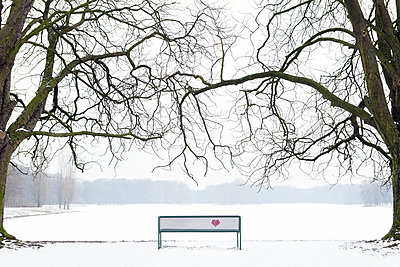 Embroidered heart at bench in winter landscape - p300m1469852 by Petra Stockhausen