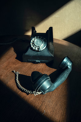 Vintage 1940's black bakelite telephone with broken cord - p1047m2073077 by Sally Mundy