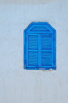 Blue Window Shutters in White Wall - p1072m1056667 by chinch gryniewicz