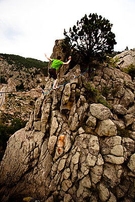 A male highliner walks the Elephant Buttresses highline in Boulder Canyon - p343m801180f by Kyle Sparks
