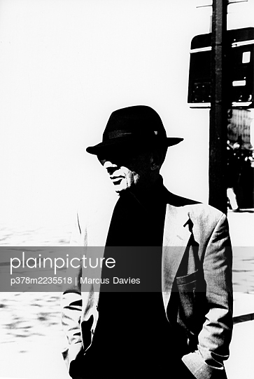Man in hat and suit - p378m2235518 by Marcus Davies