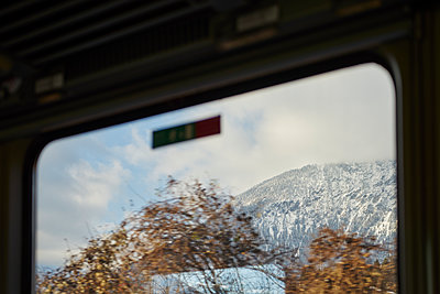 Mountain range seen through train window - p1312m1575165 by Axel Killian